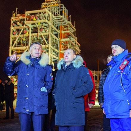Russian President Vladimir Putin (C), accompanied by Novatek chief Leonid Mikhelson (2nd L) and Russia's energy minister Alexander Novak (L), visits under construction facilities of the Yamal LNG plant in the port of Sabetta on the Yamal peninsula beyond the Arctic circle on December 8, 2017.Vladimir Putin on December 8, 2017 launched a $27 billion liquefied natural gas plant in the Siberian Arctic as Russia hopes to surpass Qatar to become the world's biggest exporter of the chilled fuel. / AFP PHOTO / SPUTNIK / Alexey DRUZHININ (Photo credit should read ALEXEY DRUZHININ/AFP/Getty Images)