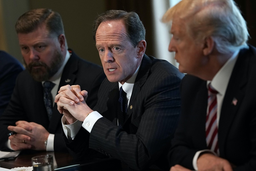 WASHINGTON, DC - FEBRUARY 13:  U.S. Sen. Pat Toomey (R-PA) (2nd L) speaks as President Donald Trump (R) listens during a meeting with congressional members in the Cabinet Room of the White House February 13, 2018 in Washington, DC. President Trump held a meeting with congressional members to discuss trade.  (Photo by Alex Wong/Getty Images)