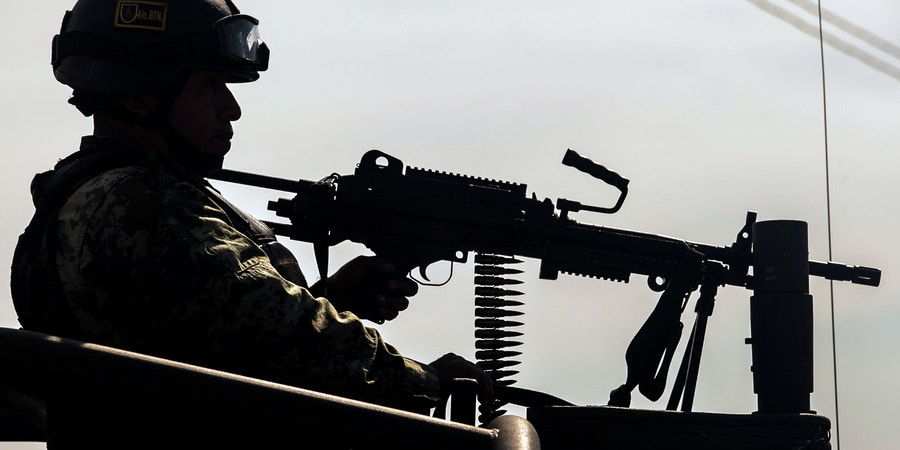 Mexican soldiers patrol during an operation against alleged members of organized crime in Culiacan, Sinoaloa state, Mexico on February 16, 2018. So far 60 people have been arrested in the party hall where the military operation was carried out. / AFP PHOTO / rashide frias (Photo credit should read RASHIDE FRIAS/AFP/Getty Images)