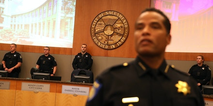 SACRAMENTO, CA - MARCH 27:  Sacramento police officer stand guard inside the council chambers after Stevante Clark, brother of Stephon Clark, disrupted a special city council meeting at Sacramento City Hall on March 27, 2018 in Sacramento, California. Hundreds packed a special city council meeting at Sacramento City Hall to address concerns over the shooting death of Stephon Clark by Sacramento police.  (Photo by Justin Sullivan/Getty Images)