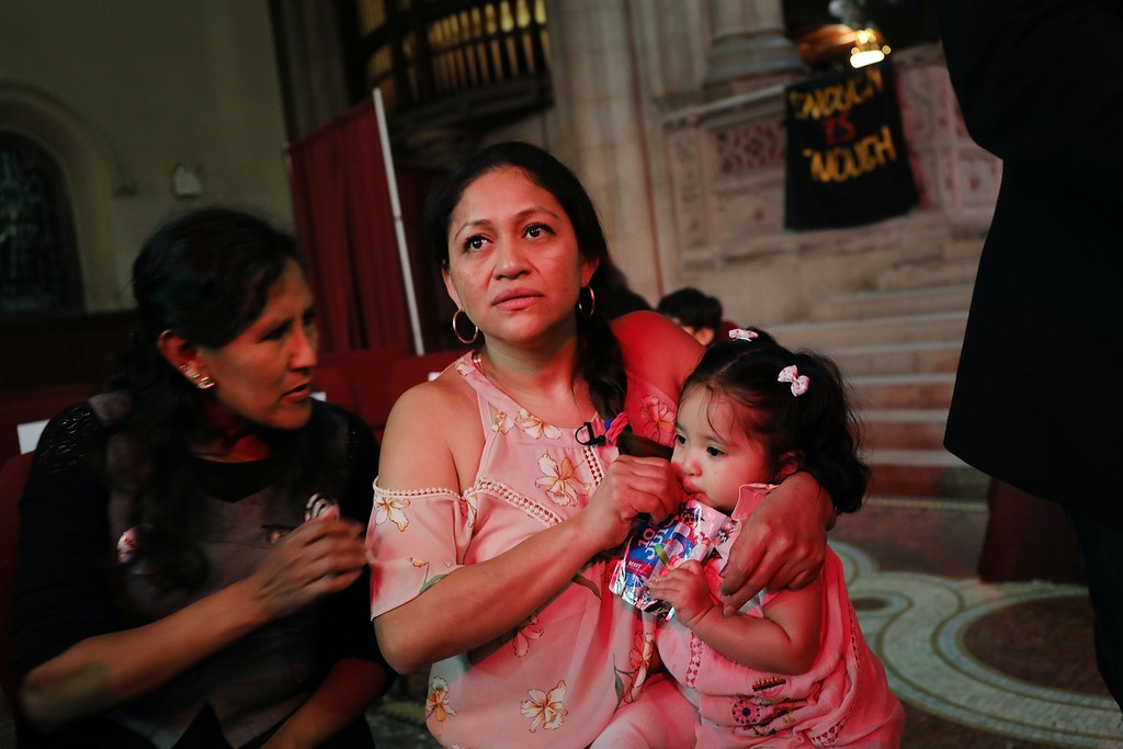 NEW YORK, NY - MARCH 29:  Aura Hernandez, a 37-year-old woman from Guatemala taking sanctuary in a Manhattan church, holds her 15-month-old daughter during a vigil and procession in cordination with the New Sanctuary Coalition on March 29, 2018 in New York City. The immigrant mother of two is desperately trying to avoid being deported back to Guatemala by immigration agents. As the Trump administration continues to go after immigrants to deport, there are currently 42 immigrants in 25 states seeking sanctuary in houses of worship.  (Photo by Spencer Platt/Getty Images)