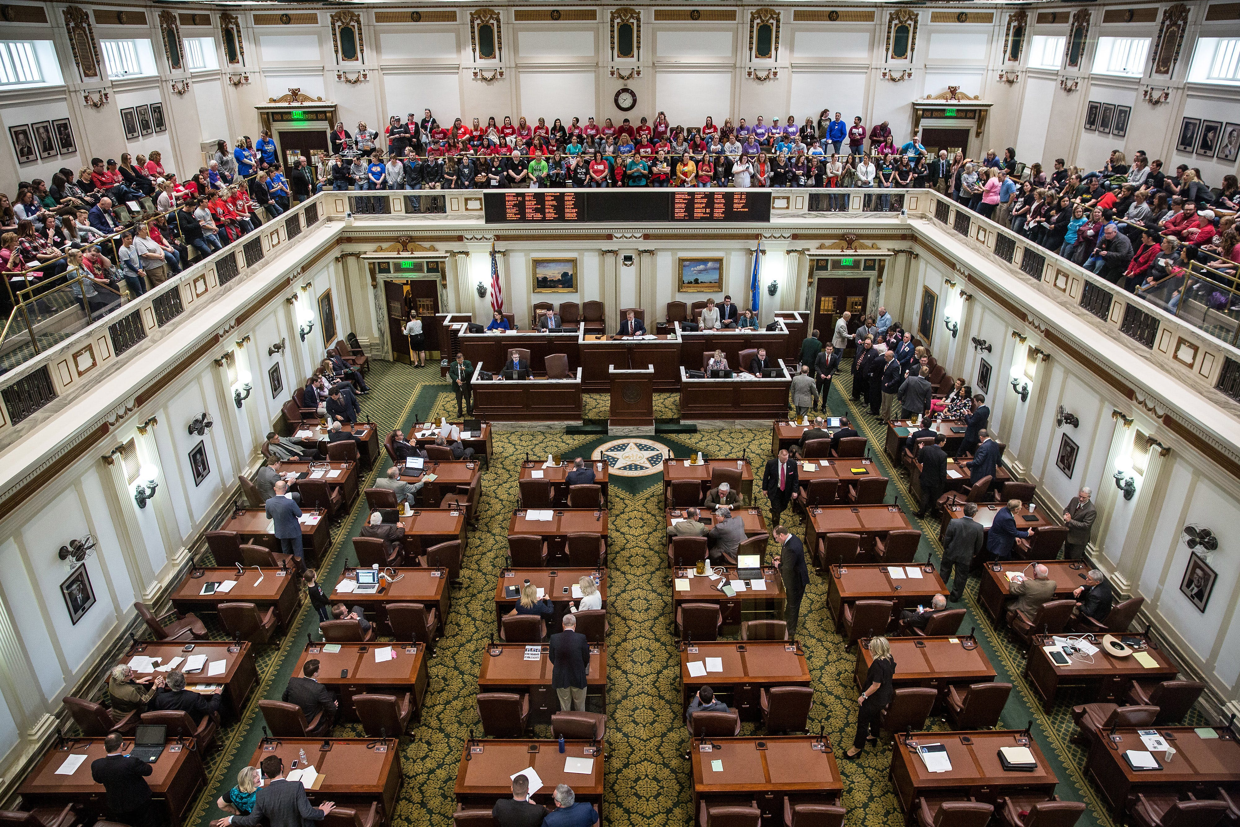 Teachers and demonstrators sit in the upstairs gallery inside the Oklahoma State Capitol building in Oklahoma City, Oklahoma, U.S., on Tuesday, April 3, 2018. Hundreds of teachers crowded into the Oklahoma Capitol for a second day Tuesday to press demands for additional funding for the state's public schools. Photographer: Scott Heins/Bloomberg via Getty Images