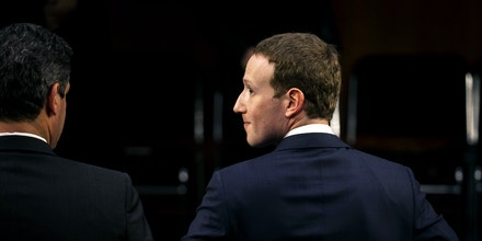 Mark Zuckerberg, chief executive officer and founder of Facebook Inc., departs for a break during a joint hearing of the Senate Judiciary and Commerce Committees in Washington, D.C., U.S., on Tuesday, April 10, 2018. Zuckerberg apologized, defended his company, and jousted with questioners while agreeing with others during his first-ever congressional testimony. Early reviews on his effort to restore trust with lawmakers and the public were mostly positive. Photographer: Al Drago/Bloomberg via Getty Images