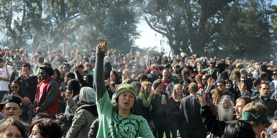 SAN FRANCISCO - APRIL 20:  A cloud of smoke rests over the heads of a group of people during a 420 Day celebration on