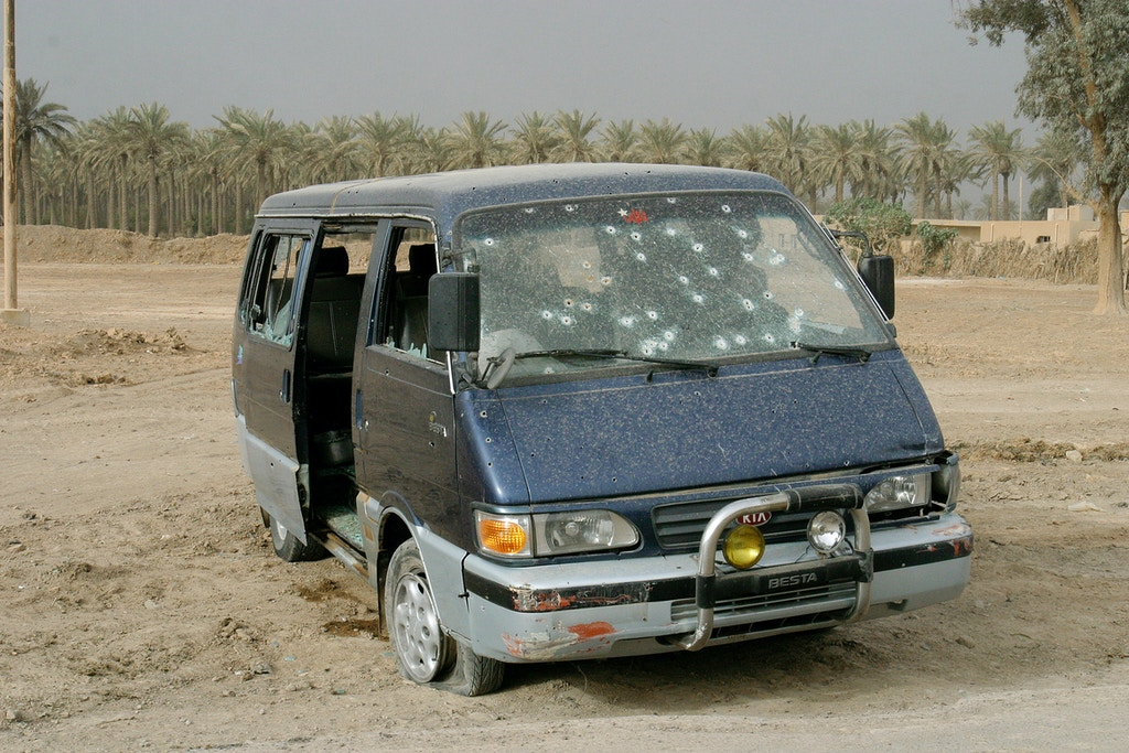 Iraq, O4-09-03<br /> Few bodies of civilians shot dead by the 4th marine on their advance in the outskirts of Baghdad.<br /> More than One hundred bullets hit this van.<br /> Photo Laurent Van der Stockt/Gamma