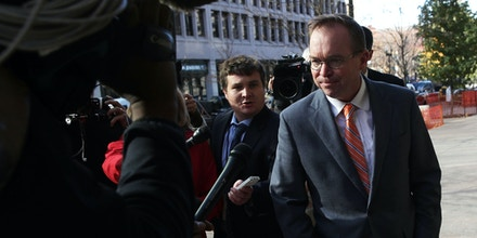 WASHINGTON, DC - NOVEMBER 27:  White House Budget Director Mick Mulvaney (C), President Donald Trump's pick for acting director of the Consumer Financial Protection Bureau, walks back to the White House from the CFPB building after he showed up for his first day of work on November 27, 2017 in Washington, DC. President Trump picked Mulvaney as the acting director after former director Richard Cordray stepped down and named his chief of staff Leandra English as acting director, setting up a possible court battle over who will eventually lead the agency.  (Photo by Alex Wong/Getty Images)