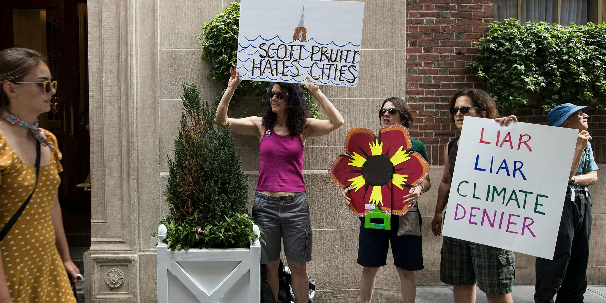 NEW YORK, NY - JUNE 20: Environmental activists protest outside of the Harvard Club where Environmental Protection Agency (EPA) Administrator Scott Pruitt was scheduled to speak, June 20, 2017 in New York City. Pruitt abruptly cancelled his appearance, where he was supposed to discuss the United States' environmental role in the world following the decision to withdraw the United States from the Paris Climate Accord. (Photo by Drew Angerer/Getty Images)