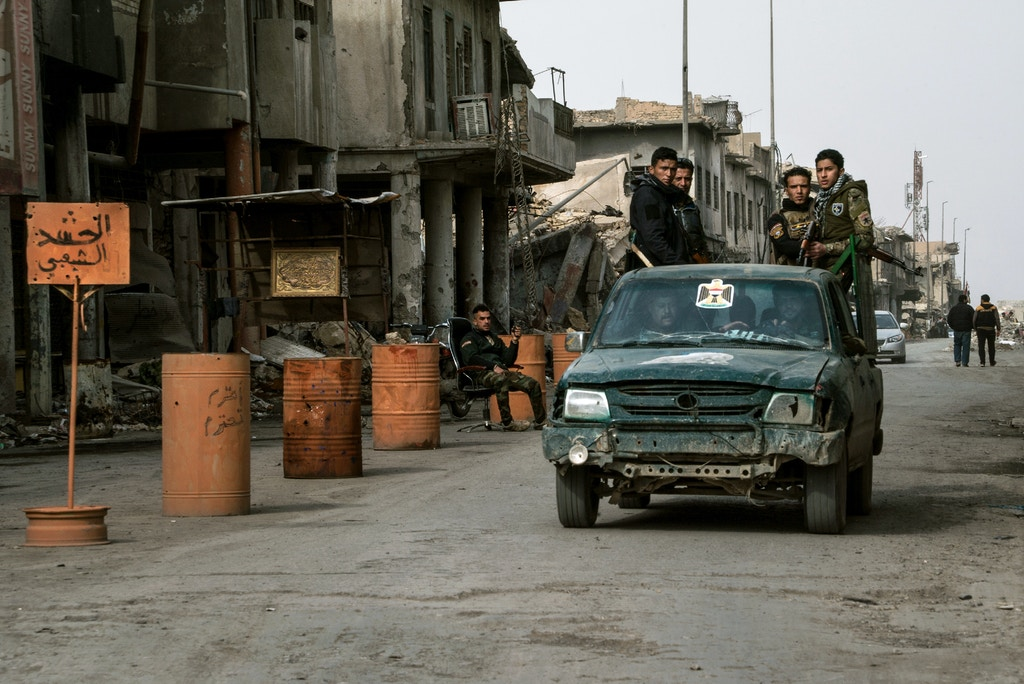Soldiers at a PMF checkpoint in the Old City of Mosul.