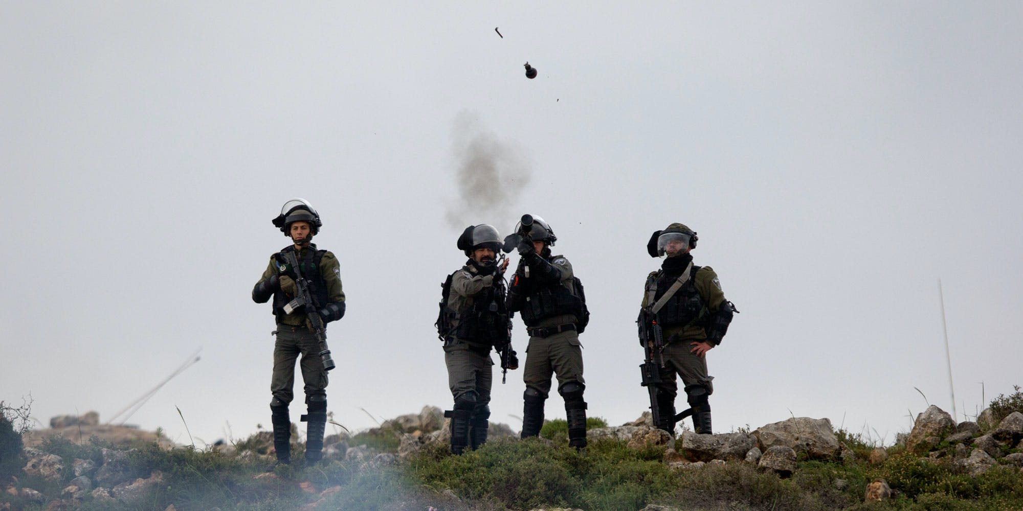 Israeli troops fire teargas at protesters during a clashes following a protest to mark the Land Day, in the village of Qusra, near the West Bank City of Nablus, Friday, March 30, 2018. (AP Photo/Majdi Mohammed)