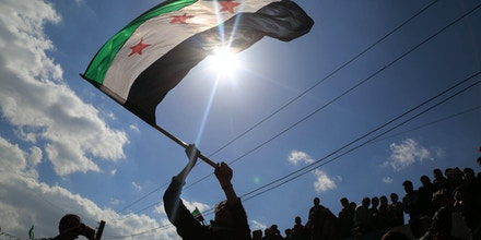 Syrian take part in a protests in the rebel-held town of Saqba, on the outskirts of the Syrian capital Damascus, on March 18, 2016.Hundreds of demonstrators took to the streets across opposition strongholds in Syria to mark the fifth anniversary of the outbreak of the revolt against President Bashar al-Assad's regime. / AFP / AMER ALMOHIBANY (Photo credit should read AMER ALMOHIBANY/AFP/Getty Images)