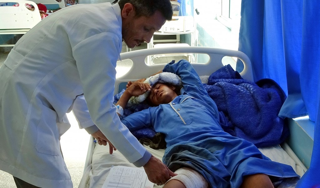 A Yemeni man, injured in an air raid on a wedding party in Yemen, receives treatment at a hospital in Yemen's Hajjah province on April 23, 2018. - Dozens were killed and wounded in an air raid on a wedding party in Yemen, local officials said Monday, with Huthi rebels blaming a Saudi-led military coalition. (Photo by ESSA AHMED / AFP)        (Photo credit should read ESSA AHMED/AFP/Getty Images)