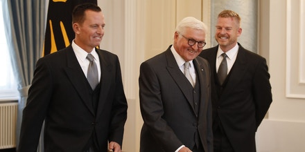Newly accredited US Ambassador Richard Allen Grenell (L), his partner Matt Lashey (R) and German President Frank-Walter Steinmeier walk during an accreditation ceremony for new Ambassadors in Berlin, Germany, on May 08, 2018. (Photo by Odd ANDERSEN / AFP)        (Photo credit should read ODD ANDERSEN/AFP/Getty Images)
