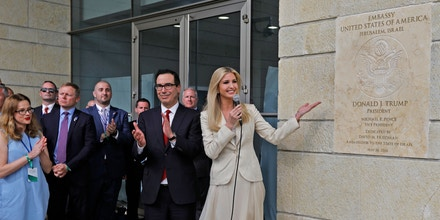 TOPSHOT - US Treasury Secretary Steve Mnuchin (C-L) claps as US President's daughter Ivanka Trump unveils an inauguration plaque during the opening of the US embassy in Jerusalem on May 14, 2018. - The United States moved its embassy in Israel to Jerusalem after months of global outcry, Palestinian anger and exuberant praise from Israelis over President Donald Trump's decision tossing aside decades of precedent. (Photo by Menahem KAHANA / AFP)        (Photo credit should read MENAHEM KAHANA/AFP/Getty Images)