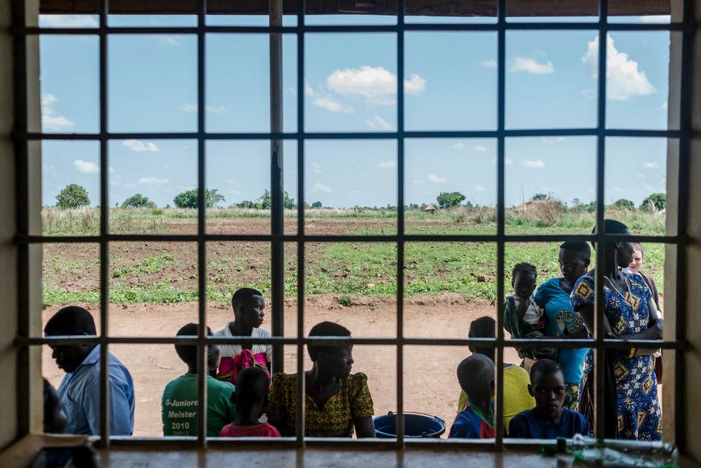 Women wait outside a local clinic to get family planning methods on March 26, 2018 in Parabongo, Uganda.