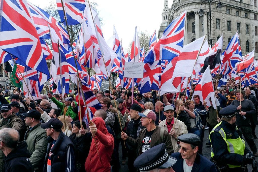 Protesters hold placards and British Union Jack flags during a protest titled 'London march against terrorism' in response to the March 22 Westminster terror attack on April 1, 2017 in London, England. The march has been organised by far-right groups English Defence League and Britain First, which also sees a counter-protest held by group 'Unite Against Fascism'. (Photo by Jay Shaw Baker/NurPhoto) *** Please Use Credit from Credit Field ***(Sipa via AP Images)