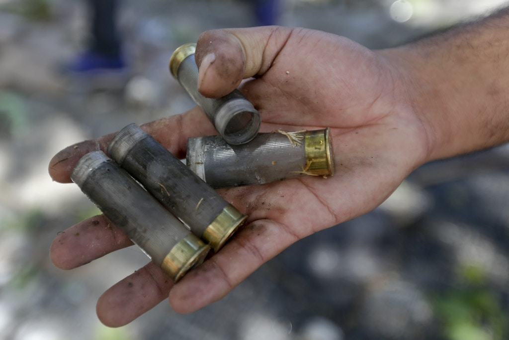 A protester shows spent rubber bullet casings shot by police during a general strike against a pension reform measure, outside Congress in Buenos Aires, Argentina, Monday, Dec. 18, 2017. Union leaders complain the legislation, which already passed in the Senate, would cut pension and retirement payments as well as aid for some of poor families. (AP Photo/Victor R. Caivano)