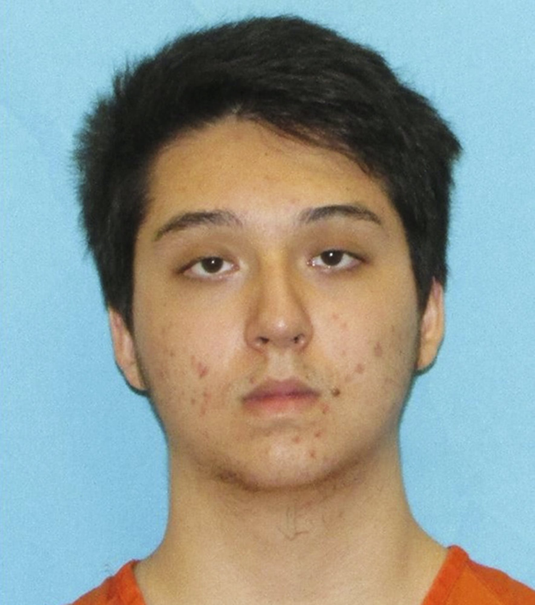 This photo provided by the Collin County District Attorney's office in Texas shows Matin Azizi-Yarand, a teenager from Plano, Texas, who has been charged with criminal solicitation of capital murder and making a terroristic threat. Azizi-Yarand is accused of planning a mass shooting at a mall inspired by the Islamic State terror group. He is being held Wednesday, May 2, 2018, at the Collin County jail in McKinney. (Collin County District Attorney's office via AP)