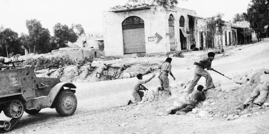 A detachment of Israeli soldiers with motorized support presses on during a recent attack on a small village somewhere in the Negev area of Palestine, Jan. 6, 1949. Resumption of fighting late in December resulted in a cease-fire order by the U.N. Security Council. An Israeli foreign office spokesman said Israeli troops have withdrawn after piercing 30 miles into Egypt and inflicting heavy casualties on Egyptian forces in three days fighting. (AP Photo)
