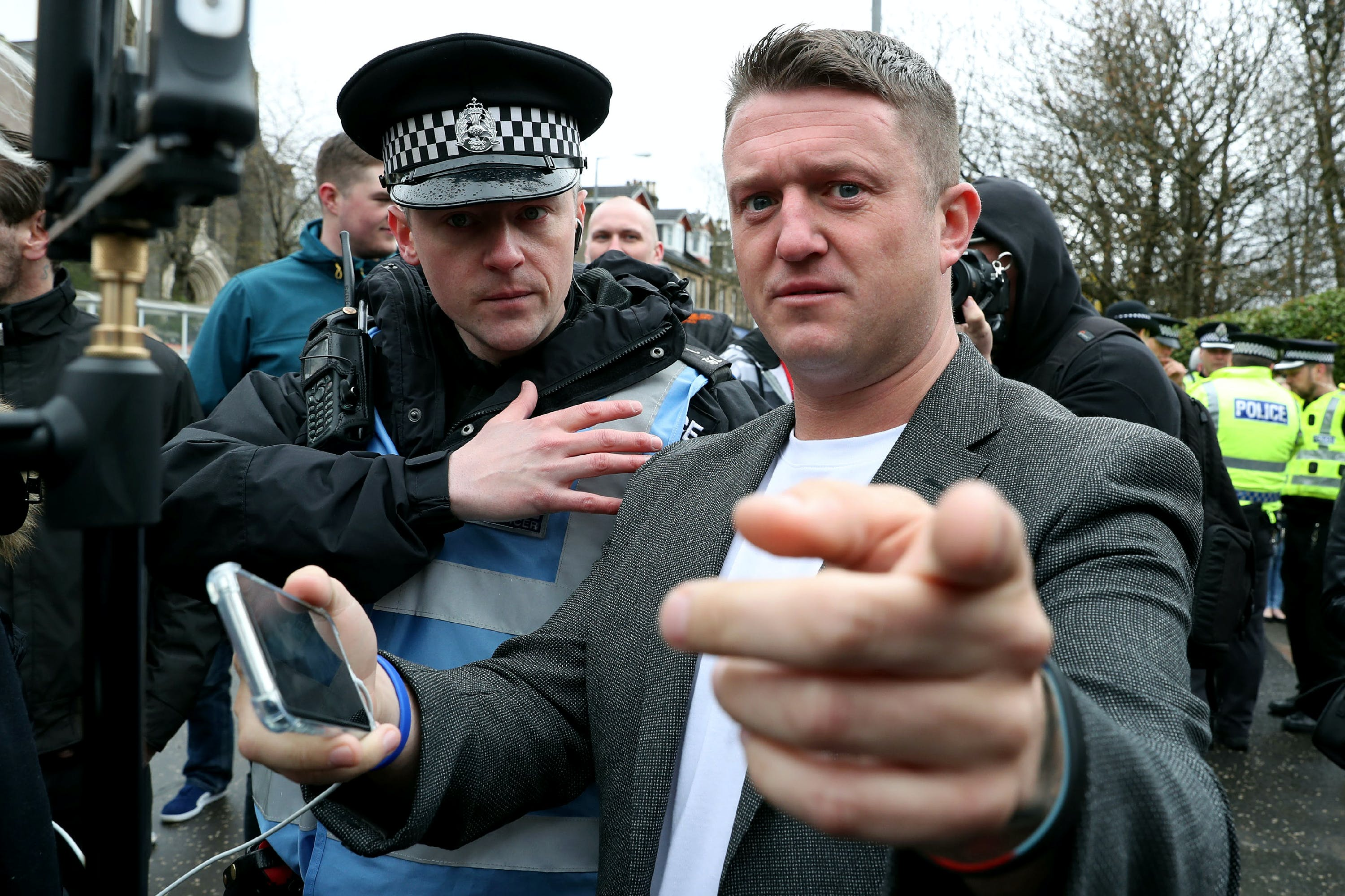 Mark Meechan court case. Former English Defence League leader Tommy Robinson outside Airdrie Sheriff Court after Mark Meechan was fined £800 for an offence under the Communications Act for posting a YouTube video of a dog giving Nazi salutes. Picture date: Monday April 23, 2018. See PA story COURTS Dog. Photo credit should read: Andrew Milligan/PA Wire URN:36143385
