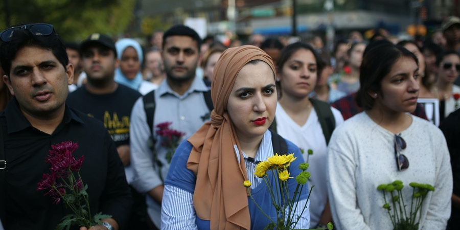 NEW YORK, USA - JUNE 20: People hold flowers during a vigil in Union Square of Manhattan borough of New York, United States on June 20, 2017, for Nabra Hassanen, a 17-year-old Muslim girl that was killed in a road rage incident on June 18. A tight-knit Muslim community in the suburbs of Washington was in shock after the 17-year-old girl was apparently beaten to death and dumped in a pond following late-night prayers at the local mosque. Police in Fairfax County, Virginia, have charged a 22-year-old local man, Darwin Martinez Torres, with the teenager's killing but said it was an apparent road rage incident. (Photo by Mohammed Elshamy/Anadolu Agency/Getty Images)