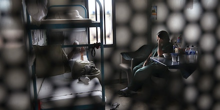 ELOY, AZ - JULY 30:  Immigrants sit in their housing cell in the women's wing of the detention facility for illegal immigrants on July 30, 2010 in Eloy, Arizona. Most immigrants at the center are awaiting deportation or removal and return to their home countries, while some are interned at the facility while their immigration cases are being reviewed. The U.S. Immigration and Customs Enforcement (ICE), in Arizona holds almost 3,000 immigrants statewide, all at the detention facilities in  Eloy and nearby Florence. Arizona, which deports and returns more illegal immigrants than any other state, is currently appealing a judge's ruling suspending controversial provisions of Arizona's immigration enforcement law SB 1070.  (Photo by John Moore/Getty Images)