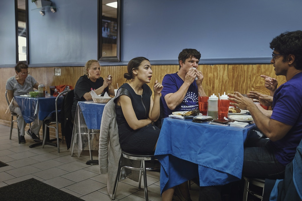 Congressional candidate Alexandria Ocasio-Cortez, third left, have dinner with militants of her campaign after a meeting, at a latin restaurant in Bronx,  New York, Saturday, April 21, 2018. (Photo: Andres Kudacki)