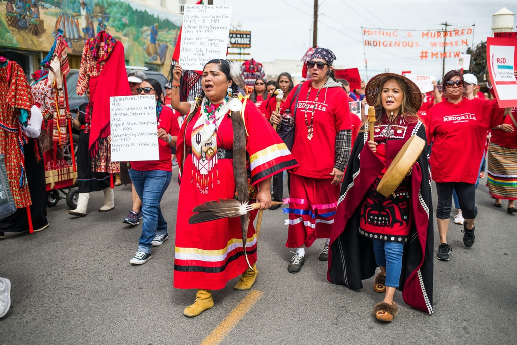 More than 50 people walk through downtown Toppenish, Wash. wearing red to bring awareness to missing and murdered indigenous women during REDgalia on Saturday, May 5, 2018. The event, organized by the Yakama Nation Victim Resource Program, started with a rally in Old Timers Plaza before a march to Yakama Nation Tribal School. (Jake Parrish, Yakima Herald-Republic)