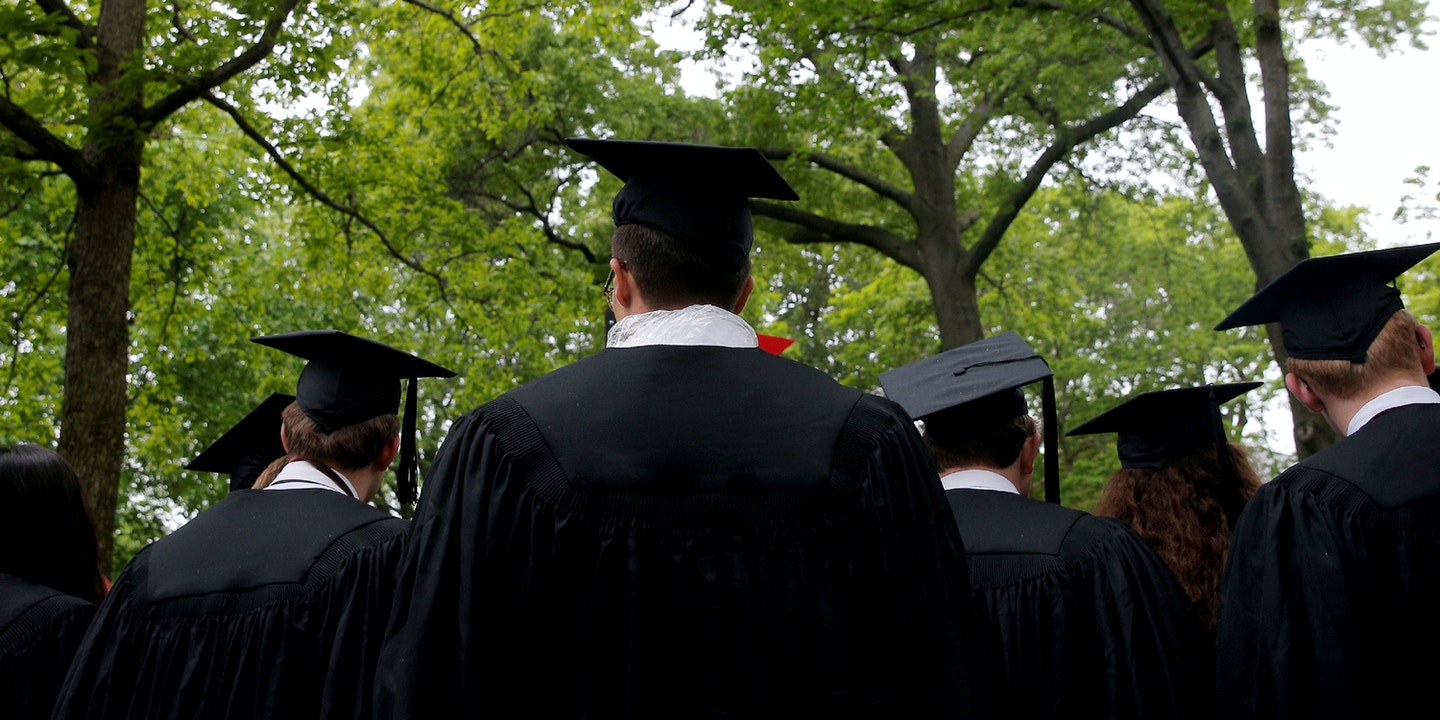 Graduating students line up for the 366th Commencement Exercises at Harvard University in Cambridge, Massachusetts, U.S., May 25, 2017. REUTERS/Brian Snyder - RC1AC9947350