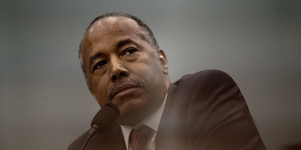 Ben Carson, secretary of Housing and Urban Development (HUD), listens during a House Appropriations Subcommittee hearing in Washington, D.C., U.S., on Tuesday, March 20, 2018. The order of a $31,000 dining room table for Carson's office suite and allegations of retaliation against an official who objected to the purchase because it exceeded the $5,000 limit is already the focus of the House Appropriations Subcommittee hearing on the HUD fiscal year 2019 budget proposal. Photographer: Eric Thayer/Bloomberg via Getty Images