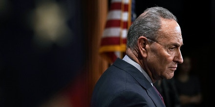 WASHINGTON, DC - DECEMBER 21:  U.S. Senate Minority Leader Sen. Chuck Schumer (D-NY) listens during a news conference at the Capitol December 21, 2017 in Washington, DC. Senate Democratic leadership held a year-end news conference to the GOP and Trump Administration.  (Photo by Alex Wong/Getty Images)