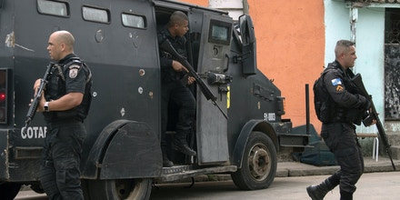 Military Police officers patrol during an operation at