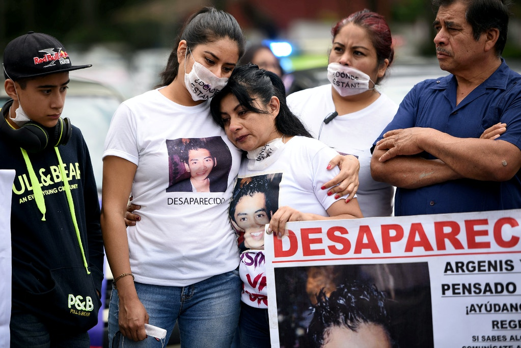 Women wearing T-shirts with pictures of missing persons, react during a march to mark Women's Day in Xalapa, in the state of Veracruz, Mexico May 10, 2018. REUTERS/Yahir Ceballos - RC1B955D4500