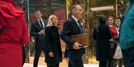 FILE -- Scott Pruitt, now the administrator of the Environmental Protection Agency, arrives with his top policy adviser, Samantha Dravis, at Trump Tower on Fifth Avenue in New York, Dec. 7, 2016. Dravis is said to be resigning from her position at the Environmental Protection Agency, according to two EPA officials who spoke on condition of anonymity because the news had not been made public. (Stephen Crowley/The New York Times)