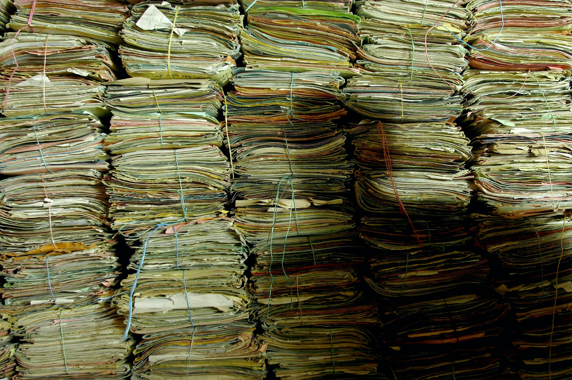 View of stacked files created by the Arab Socialist Ba'ath Party documenting torture, executions, and mass graves in Baghdad, Iraq on Oct. 19, 2003. The files are currently being handled by Kanan Makiya and his assistant, Hassan, of the Iraq Memory Foundation. Iraqi citizens and occupying forces recovered the files, which were created by Ba'ath party officials prior to the U.S. invasion.