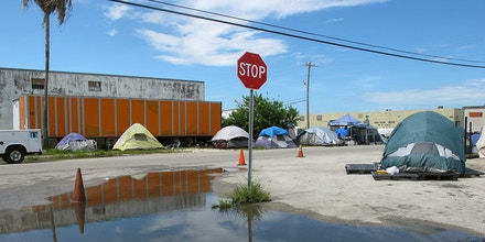 Twenty-eight camping tents sit pitched along both sides of the road in a stretch of Northwest Miami-Dade in August, 2017. The encampment is the result of a 2005 county law — much stricter than a similar measure passed by the state ten years earlier — that imposes restrictions on where sexual offenders and predators may live.
