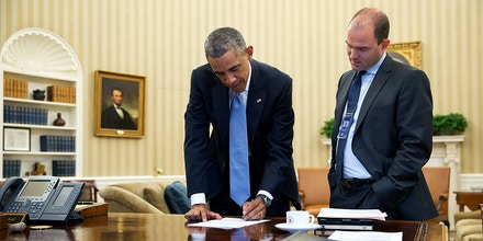 President Barack Obama confers with Ben Rhodes, Deputy National Security Advisor for Strategic Communications, in the Oval Office, Sept. 10, 2014. (Official White House Photo by Pete Souza)This official White House photograph is being made available only for publication by news organizations and/or for personal use printing by the subject(s) of the photograph. The photograph may not be manipulated in any way and may not be used in commercial or political materials, advertisements, emails, products, promotions that in any way suggests approval or endorsement of the President, the First Family, or the White House.