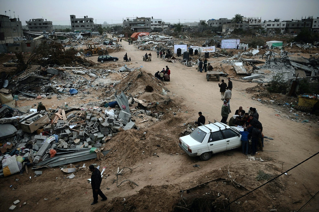 Palestinians inspect the Israeli-bombed Zeitun district of Gaza City on January 23, 2009. A Hamas delegation from Gaza crossed into Egypt for talks to shore up the ceasefire with Israel which ended a 22-day assault on the coastal strip, a border official said. Israel and Hamas have observed their own ceasefires since January 18 when Israel ended Operation Cast Lead leaving a trail of devastation and 1,330 Palestinians dead, according to doctors. Egypt is trying to secure a durable ceasefire between Israel and Hamas and the reopening of crossings. AFP PHOTO/OLIVIER LABAN-MATTEI (Photo credit should read OLIVIER LABAN-MATTEI/AFP/Getty Images)