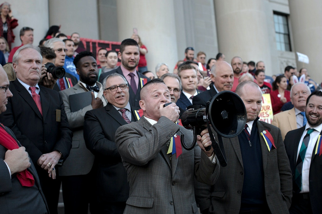 State Sen. Richard Ojeda, center, a Democrat, rallies with teachers outside of the State Capitol in Charleston, W.Va., Feb. 27, 2018. A statewide teacher strike in West Virginia entered its seventh day on March 2, with teachers defying efforts by the state's governor and union leaders to end the walkout with a deal to raise pay. (Alex Flynn/The New York Times)