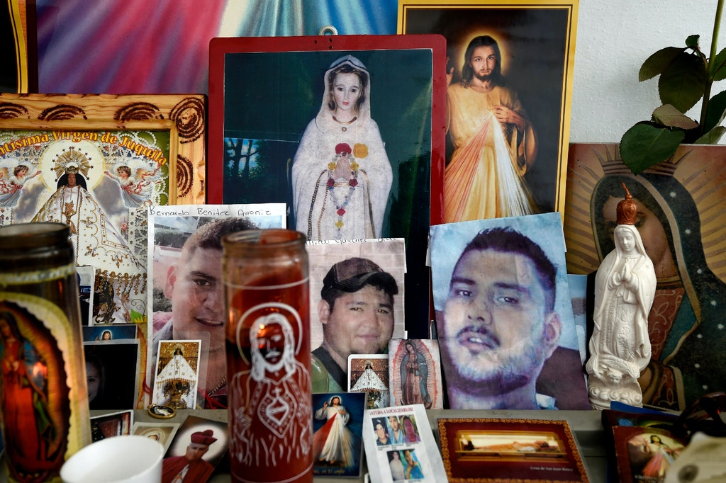 View of an altar with pictures of five youngsters who went missing past January 11 in Tierra Blanca community, Veracruz State, Mexico on January 25, 2016. The parents of five youngsters, who were taken by policemen and later supposedly handed to members of the organized crime, have camped for over 15 days at the local public prosecutor's office to put pressure on authorities to find their children. AFP PHOTO/ALFREDO ESTRELLA / AFP / ALFREDO ESTRELLA        (Photo credit should read ALFREDO ESTRELLA/AFP/Getty Images)