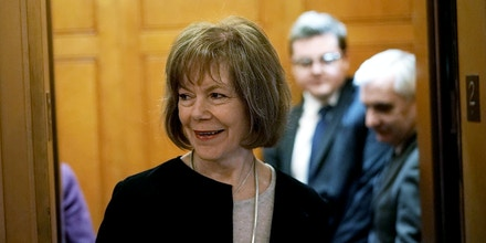 WASHINGTON, DC - FEBRUARY 12:  U.S. Sen. Tina Smith (D-MN) arrives for a vote at the Capitol February 12, 2018 in Washington, DC. The Senate has passed a procedural vote today to begin debate on immigration and border security.  (Photo by Alex Wong/Getty Images)