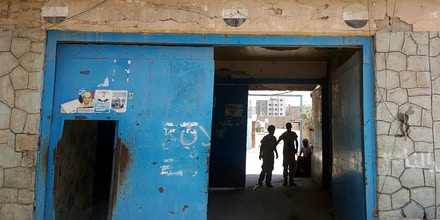 The entrance of Aden Central Prison, known as Mansoura, where one wing is run by Yemeni allies of the United Arab Emirates to detain al-Qaida suspects, is shown in this May 9, 2017 photo in Aden, Yemen. Hundreds detained in the hunt for militants have disappeared into a network of secret prisons run by the UAE and Yemeni militias it created across southern Yemen, where former detainees say torture is widespread. Some prisoners have been interrogated by Americans, witnesses say.  (AP Photo/Maad El Zikry)