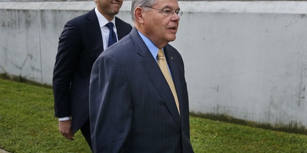 Sen. Bob Menendez, right, arrives to the courthouse with his son Robert Menendez Jr., in Newark, N.J., Wednesday, Sept. 6, 2017. The corruption trial for the New Jersey Democrat and a wealthy Florida eye doctor begins on Wednesday in Newark. The trial will examine whether Menendez was illegally lobbying for Salomon Melgen, who gave him political contributions and gifts including luxury vacations. (AP Photo/Seth Wenig)