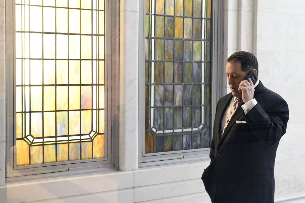 Assembly Majority Leader Joseph Morelle, D-Rochester, talks on a phone outside the Assembly Chamber at the state Capitol Thursday, March 29, 2018, in Albany, N.Y. (AP Photo/Hans Pennink)