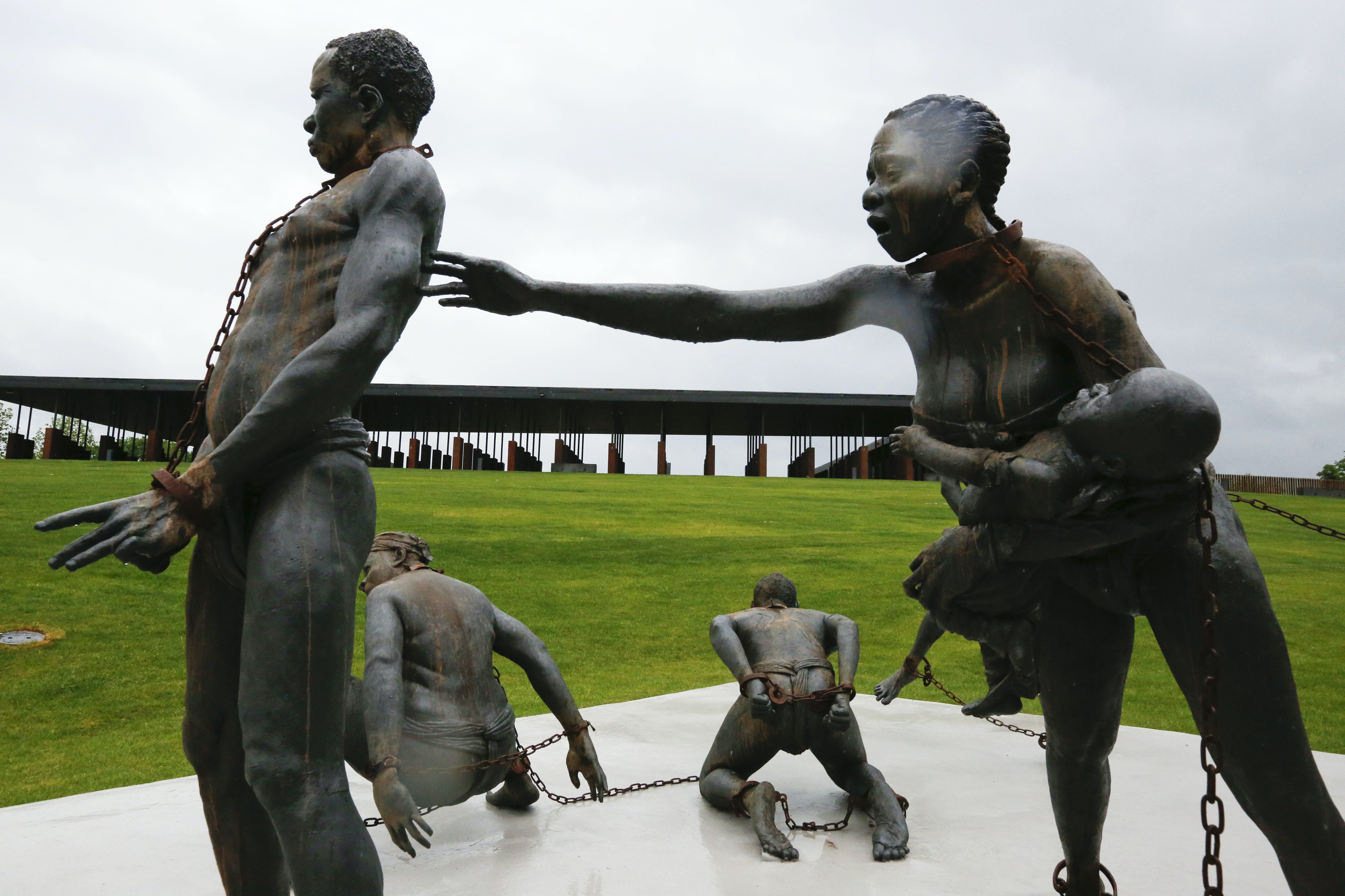 Part of a statue depicting chained people is on display at the National Memorial for Peace and Justice, a new memorial to honor thousands of people killed in racist lynchings, Sunday, April 22, 2018, in Montgomery, Ala. The national memorial aims to teach about America's past in hope of promoting understanding and healing. It's scheduled to open on Thursday. (AP Photo/Brynn Anderson)