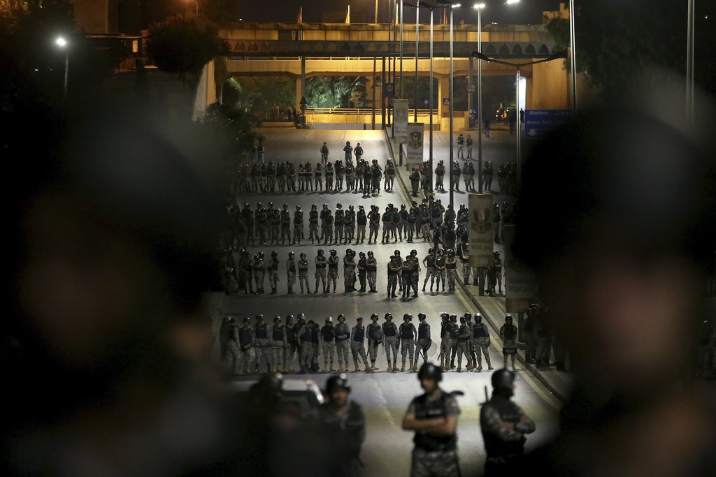 Jordanian gendarmes and Jordanian security forces are on high alert in the capital of Amman, early Tuesday, June 5, 2018. Jordan's King Abdullah II on Monday accepted the resignation of his embattled prime minister and reportedly tapped a leading reformer as a successor, hoping to quell the largest anti-government protests in recent years, which are also seen as a potential challenge to his two-decade-old rule. (AP Photo/Raad al-Adayleh)