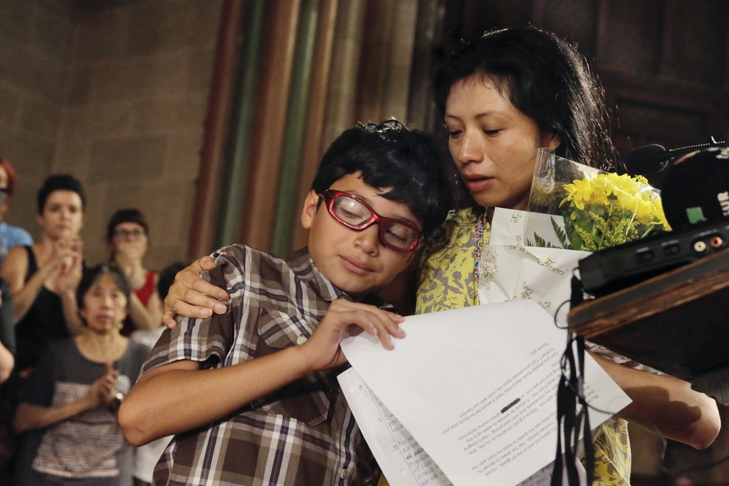 Barrios, an undocumented immigrant from Guatemala, comforts her son Kenner, 10, after he delivered his remarks at the St. Paul & St. Andrew Methodist Church in New York, Thursday, June 21, 2018. New Sanctuary Coalition held the press conference to announce that Vasquez-Barrios, and the youngest of her two children, will take sanctuary in the church on the Upper West Side of New York. (AP Photo/Richard Drew)