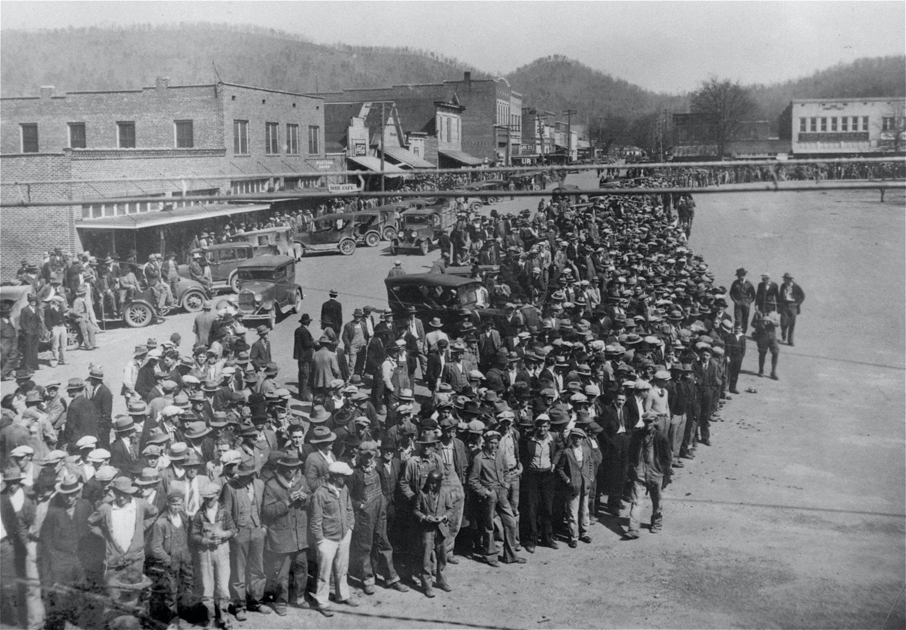 Here is shown a part of the crowd of 10,000 persons who jammed the courthouse square in the little town of Scottsboro, Alabama, April 6, 1933, on the opening of the trials of nine black youths accused of attacking two white girls near Sevenson, Ala., March 24, 1931.  National Guardsmen with fixed bayonets patrolled the courthouse grounds, and women and minors were barred from the courtroom.  The state asked for the death penalty for the first two defendants to be placed on trial.  The other seven will be tried later.  The nine were identified by the two girls as the ones who boarded the freight car in which they and seven white youths were riding, forced five of the white youths from the train, knocked the other two unconscious and attacked the girls. (AP Photo)