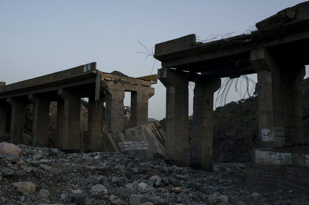 A bridge lays destroyed from an airstrike on May 6, 2018 in al Ragha Village, Bani Qais District, Hajjah, Yemen.