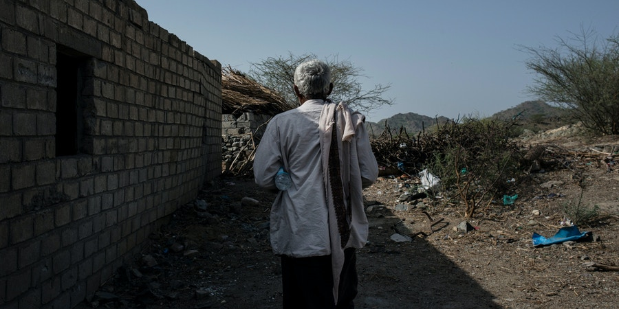 A Yemeni man walks through the rubble of a wedding tent on May 6, 2018 in al Ragha Village, Bani Qais District, Hajjah, Yemen. On April 23, a wedding in the rural area was hit by an airstrike, killing over 20 and wounding over 60.