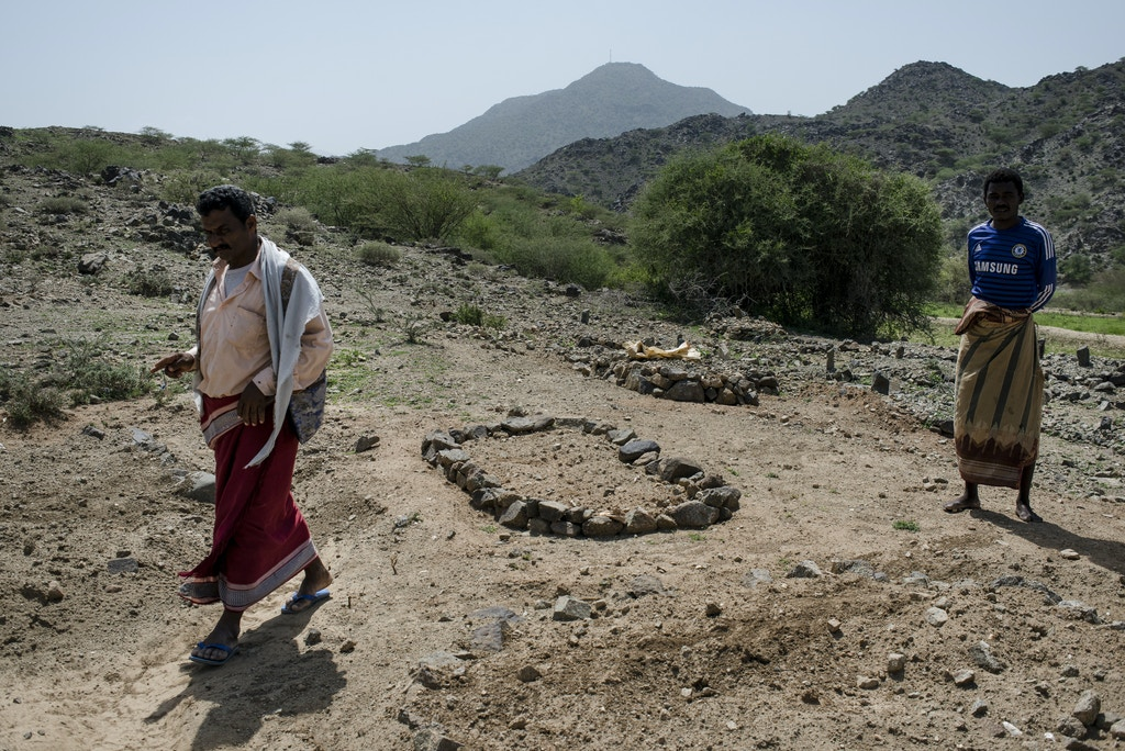Saleh Yahya, 35, walks through one of the graveyards where the dead of the wedding strike were buried on May 6, 2018 in al Ragha Village, Bani Qais District, Hajjah, Yemen.